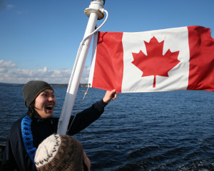ILI Student w Candian Flag on Boat
